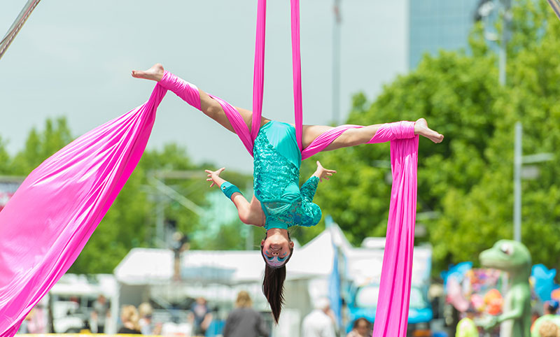 Photo of aerial ribbon performer on Performance Row at Wildflower!